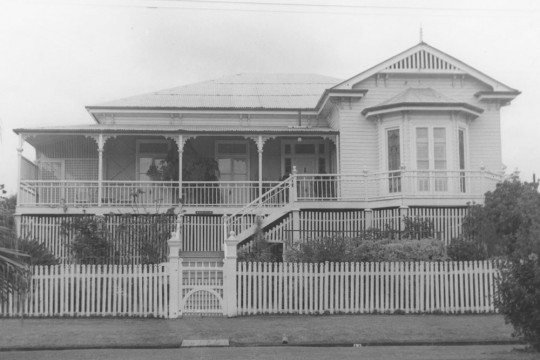 Single storey weatherboard house with a picket fence