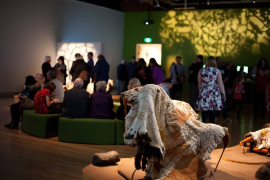 Decorated possum skin cloak on display in SLQ gallery
