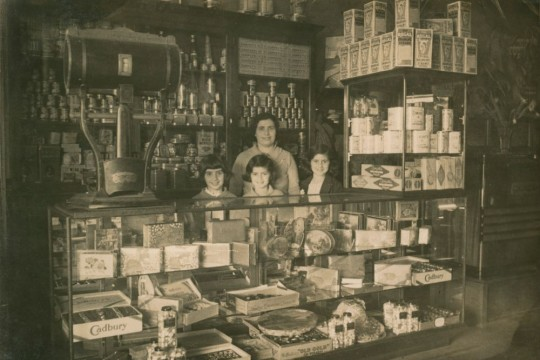 Irene Andronicus with her children Katie Ada and Mary behind Cafe Mimosa Counter Maryborough 1930