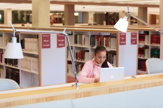 Woman using a laptop at the State Library of Queensland Photo by Jeff Camden