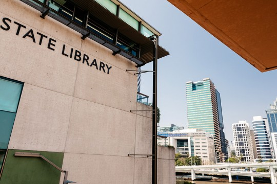 State Library building sign with the Brisbane river in the background