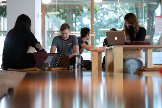Students using laptops to study at the State Library