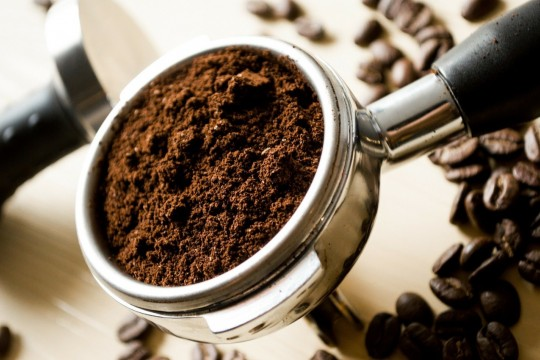 Image of coffee in a coffee grinder