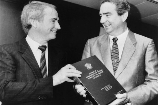 Tony Fitzgerald handing a copy of the Fitzgerald Report to Premier Mike Ahern, 1989