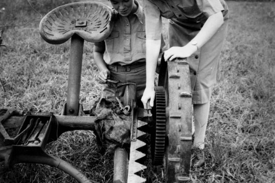 Two women working with farm machinary