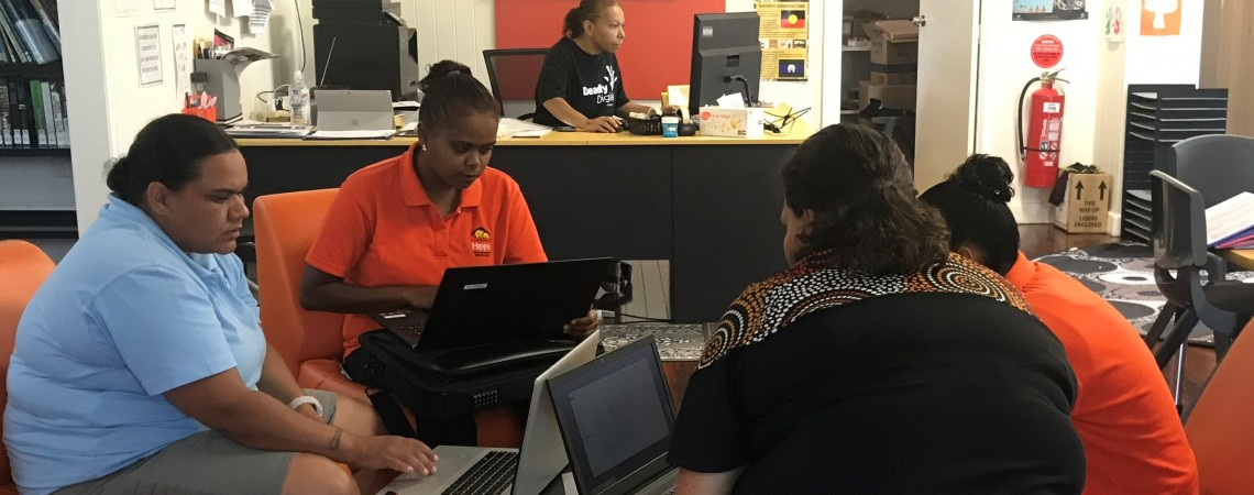 A group of women using laptops