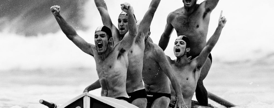 Lifesavers celebrate winning a surfboat race at a surf carnival at Kurrawa Beach, Queensland, 2001