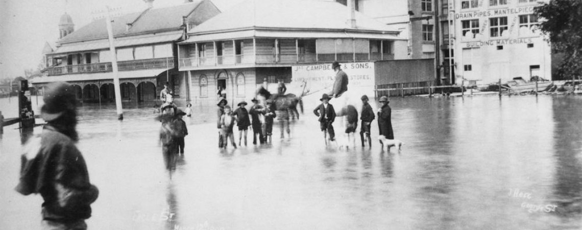 People wade through a flooded Eagle Street Brisbane during the 1890 flood