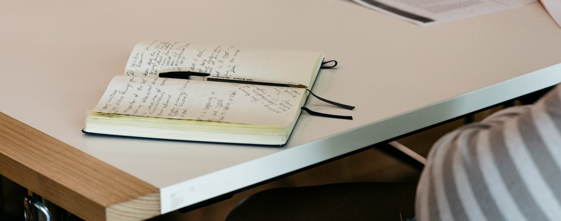Notebook with notes on table