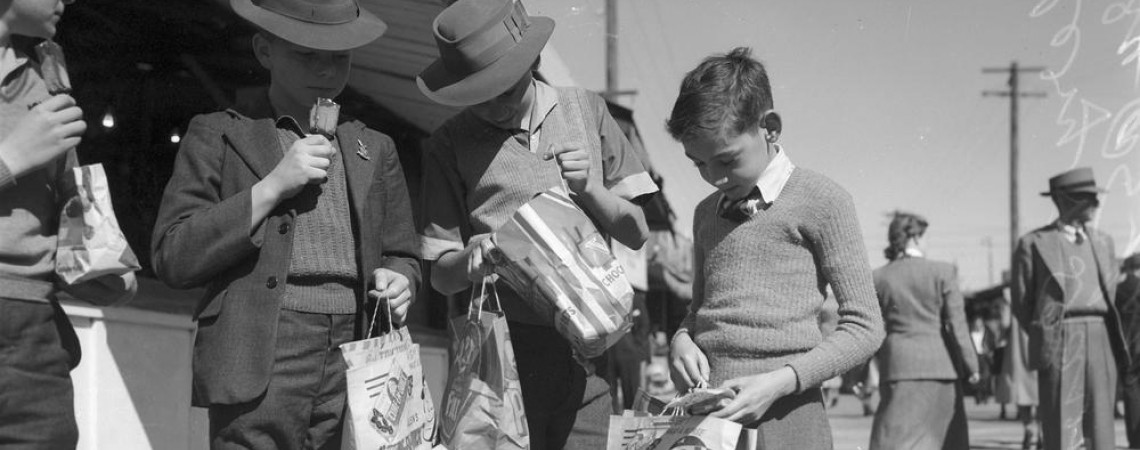 4 boys with show bags and eating ice blocks  at the Brisbane Exhibition in 1949