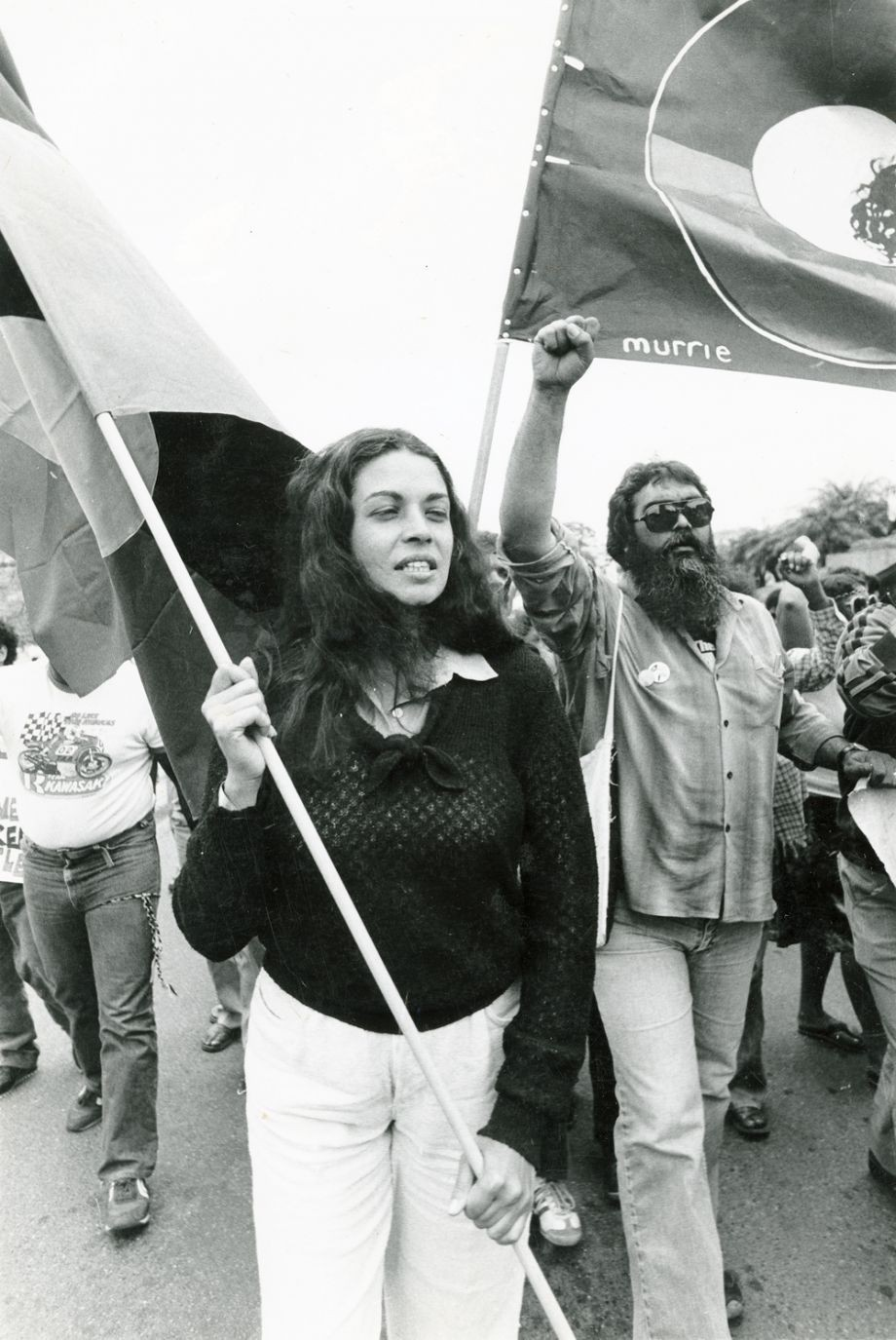 Marcia Langton foreground and Bob Weatherall right marching with protesters