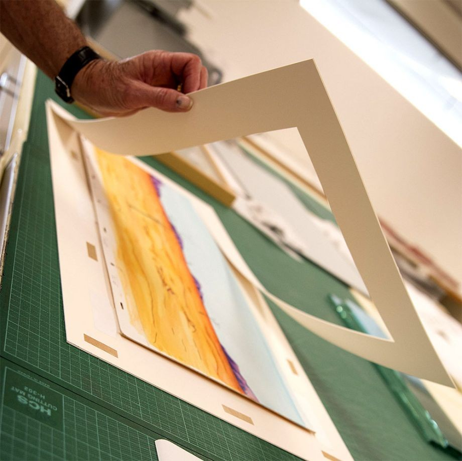 Photograph of watercolour artwork being framed from The Southern Cross