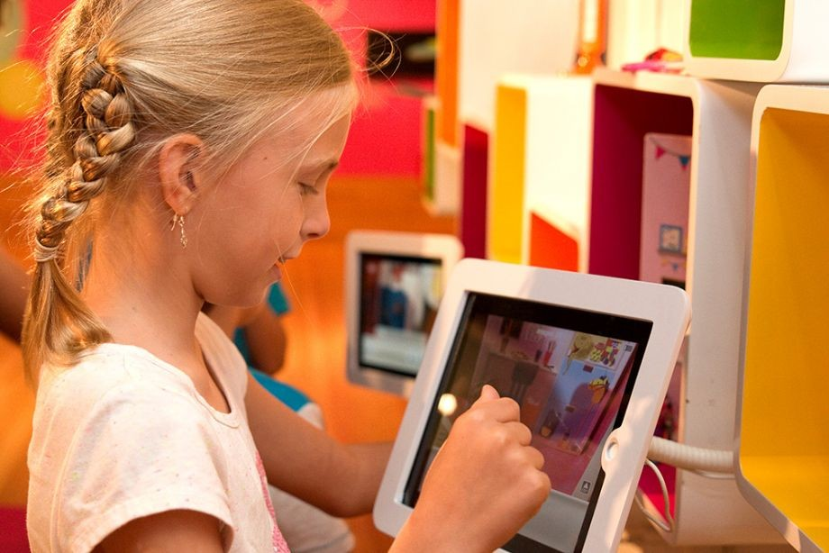 Girl plays on iPad in the Animation Studio