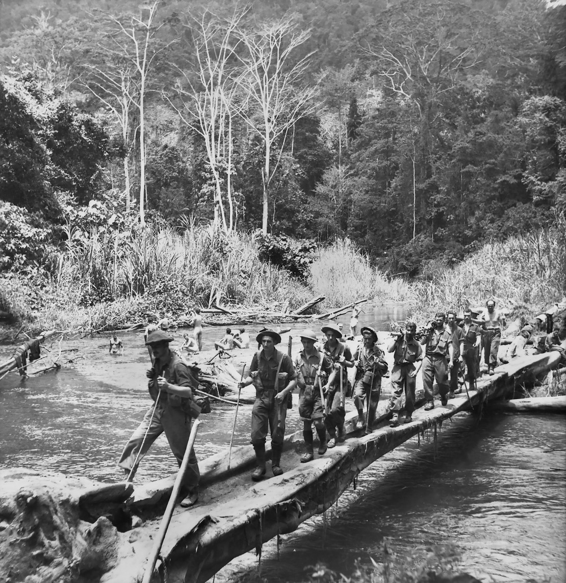 A group of troops crossing a river