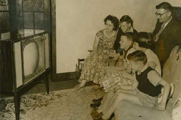 A typical family scene all eyes on the TV program 1959  Photographer unknown  John Oxley Library SLQ  Negative no 68711