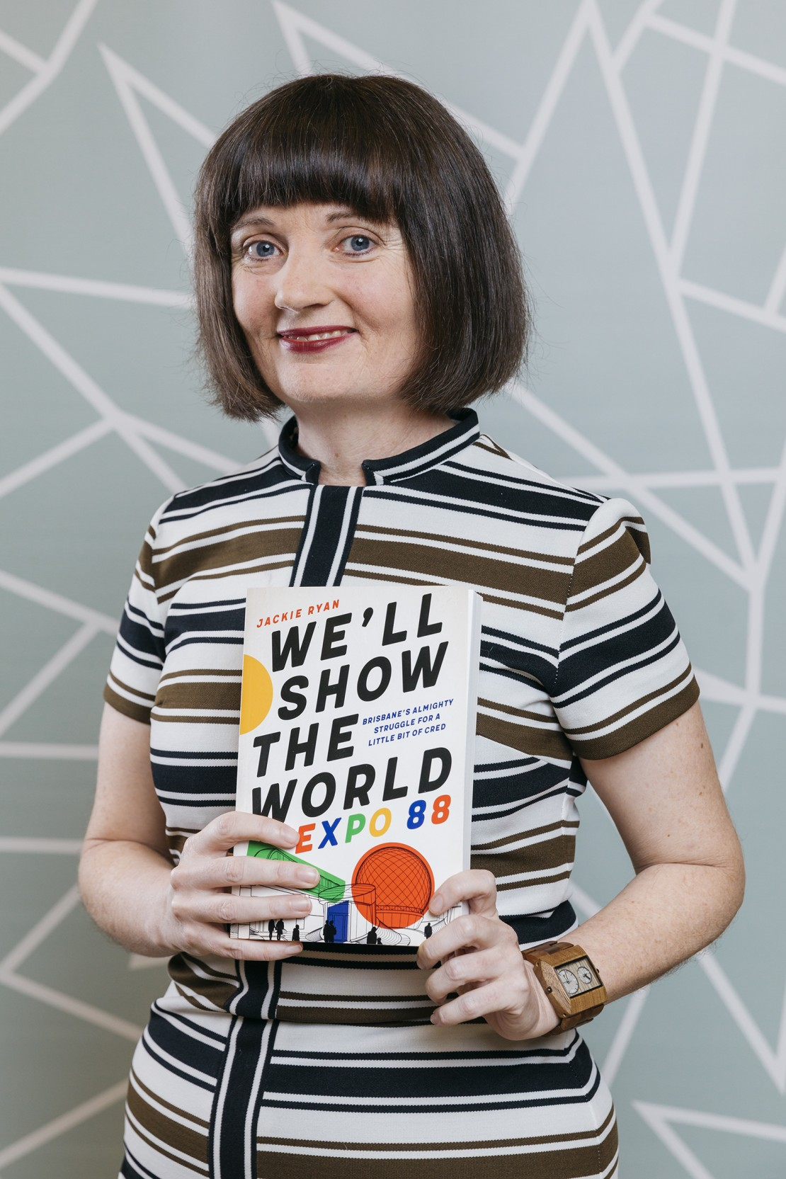 Jackie Ryan holding her book Well Show the World Expo 88