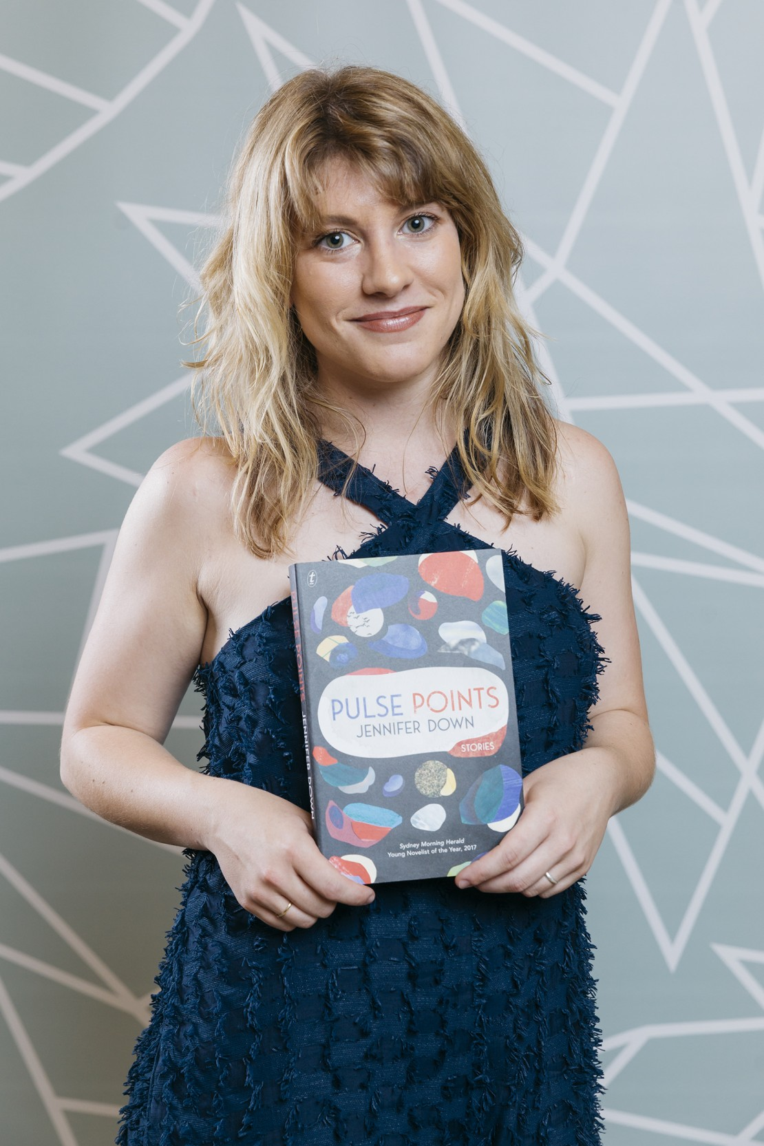 Jennifer Down holding her book Pulse Points