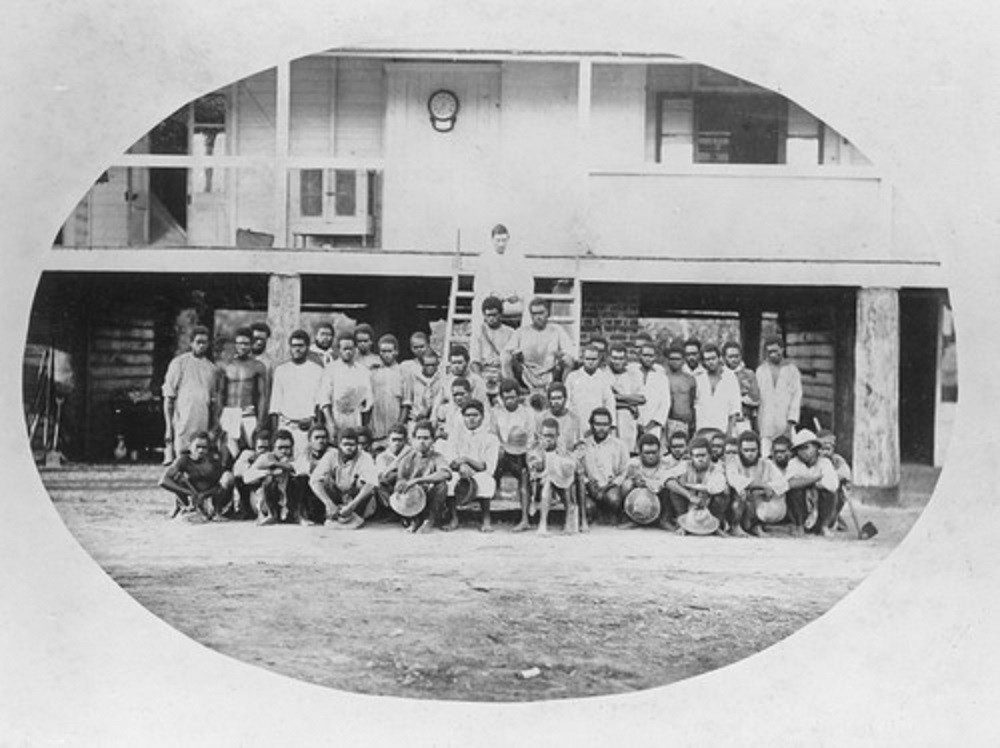 Australian South Sea Islanders outside the managers house on a sugar plantation in Macknade Queensland ca 1881 Photographer unknown John Oxley Library State Library of Queensland 6306 Album of Views of Townsville and Herbert River Image no APO-022-0001-0009