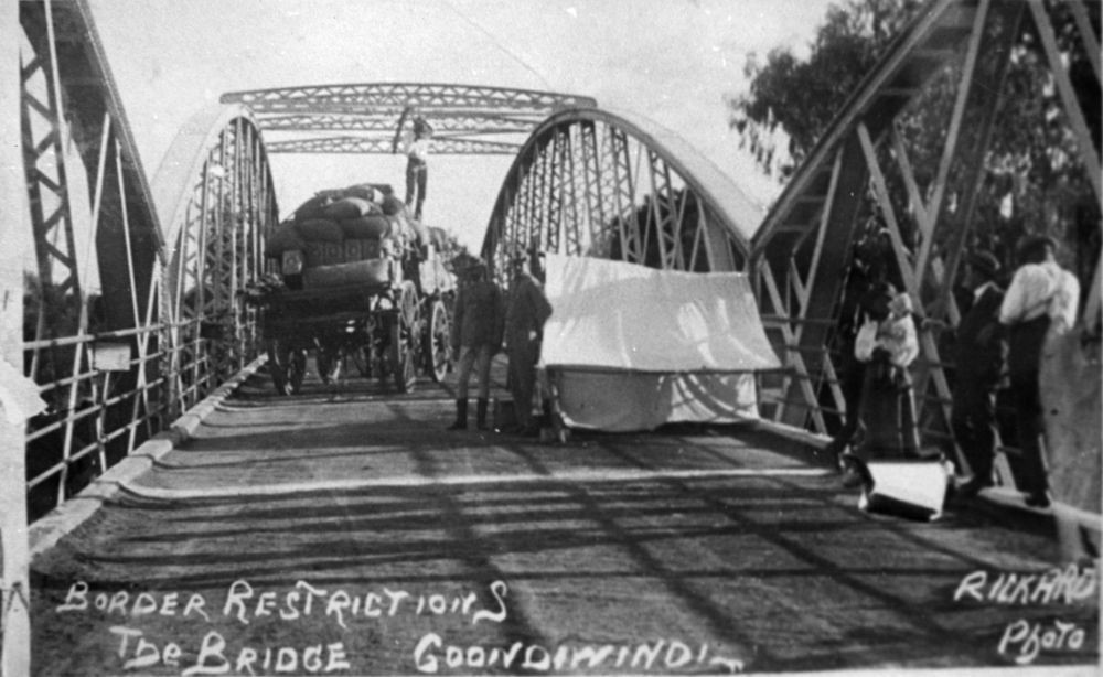People carts and horses encountering border inspection on a bridge between Queensland and New South Wales during the Spanish influenza pandemic