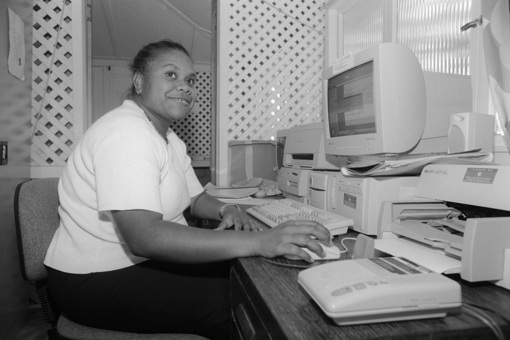 Celest Corowa using a computer inside the Mackay and District Australian South Sea Islander Association office Queensland 2000 John Oxley Library State Library of Queensland Image 28873-0001-0023
