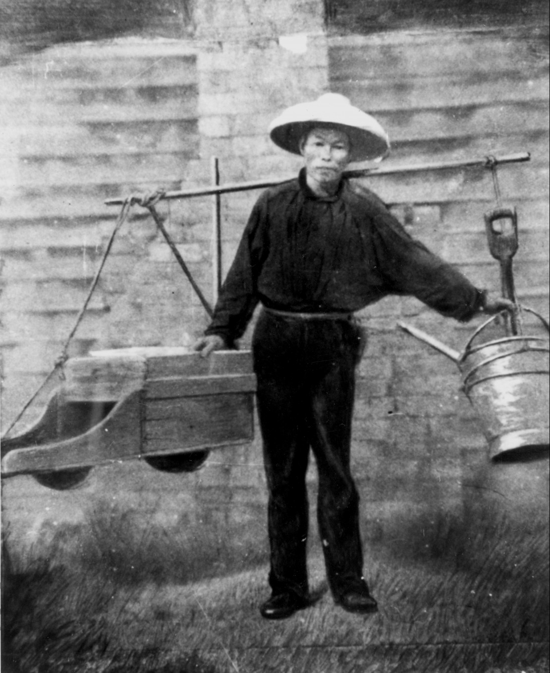 Chinese gold digger with his mining tools suspended from a yoke across his shoulders starting for work in the 1860s