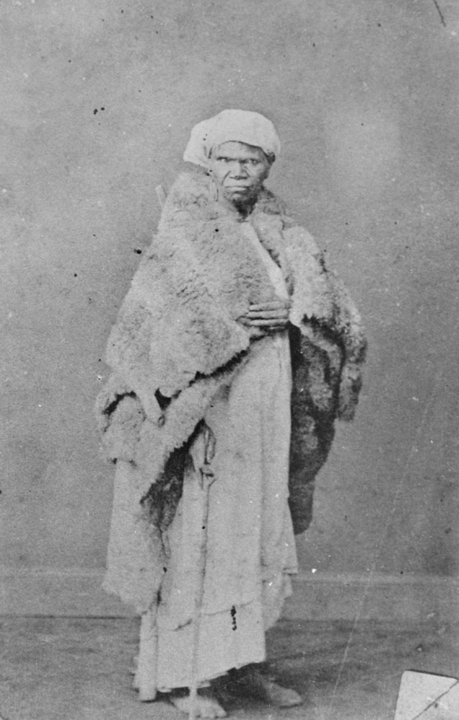 One of the few photographs of an unnamed Aboriginal woman wearing a possum skin cloak in South East Queensland