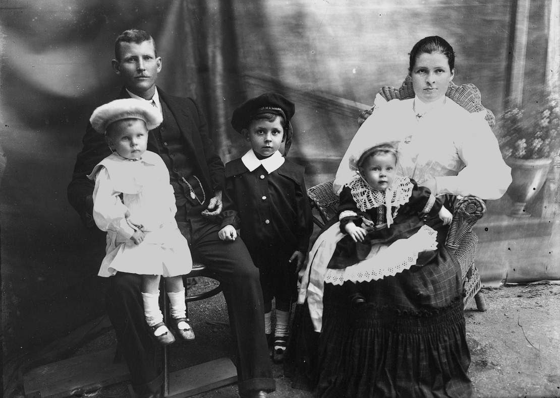 Husband and wife photographed with their three children