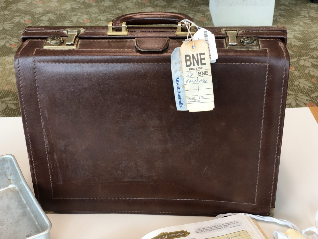 Leather briefcase used by Sir Joh that still contains an original luggage label