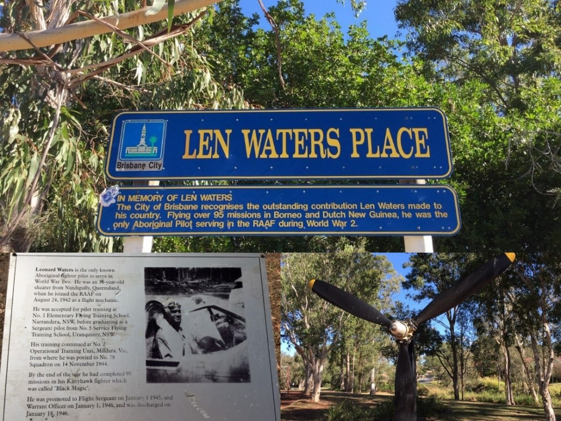 A blue sign with yellow writing saying Len Waters Place in a park