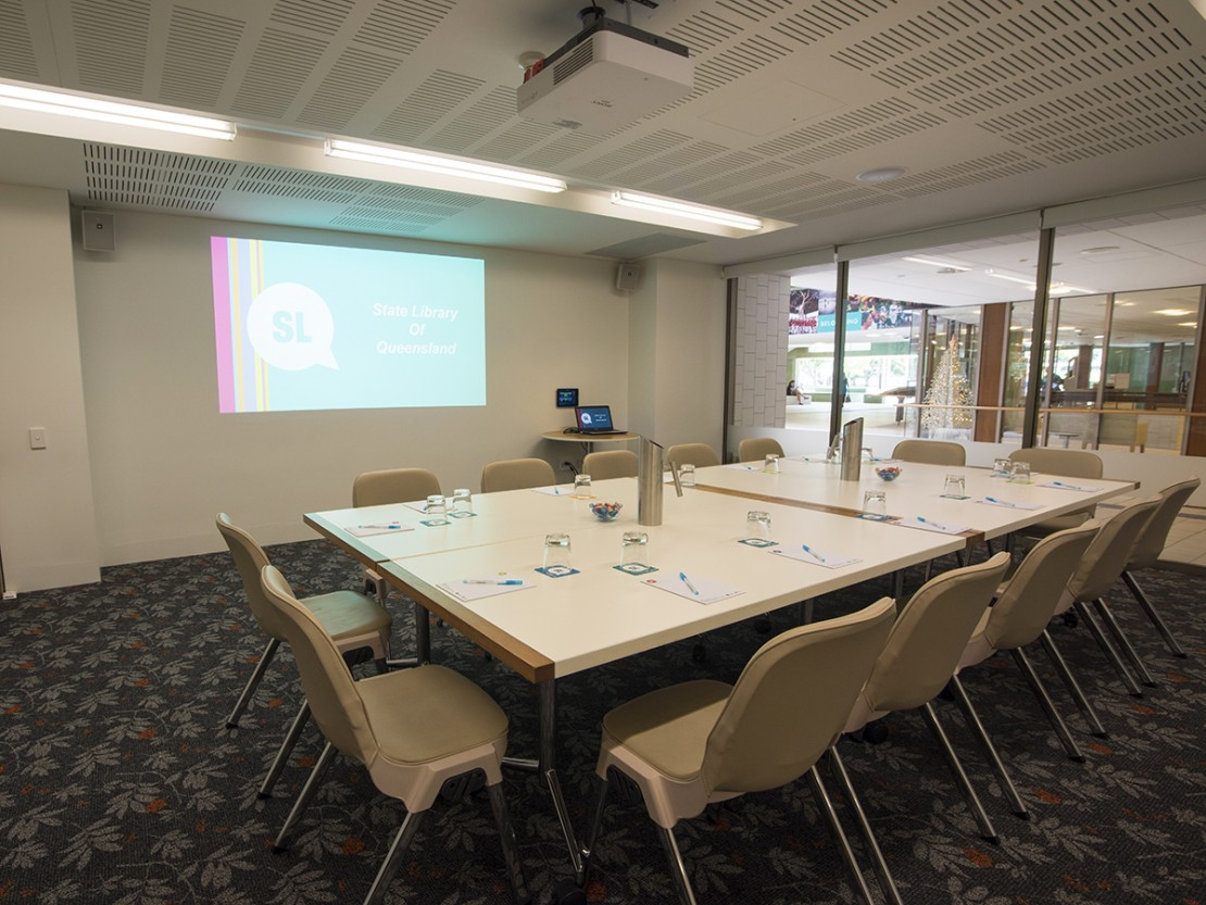 Meeting room 1A at State Library with tables and projector