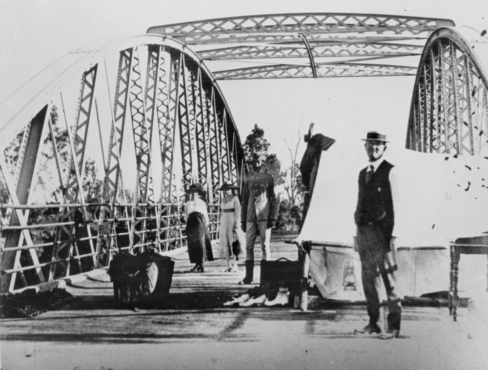 People gathering at the border crossing on a bridge during the Spanish Influenza pandemic