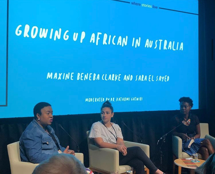 Maxine Beneba Clarke Sara El Sayed and Kathomi Gatwiri sit in front of a blue screen that says Growing Up African in Australia