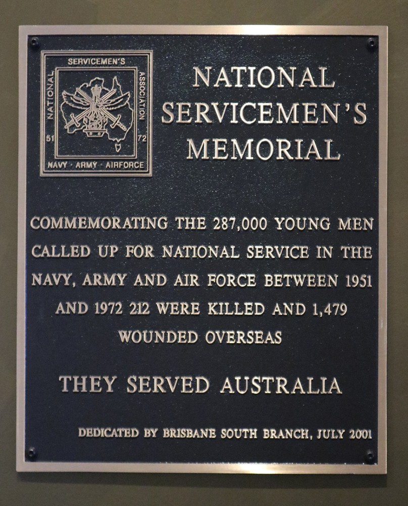 A plaque saying National Servicemens Memorial commemorating the 287 000 young men called up for national service