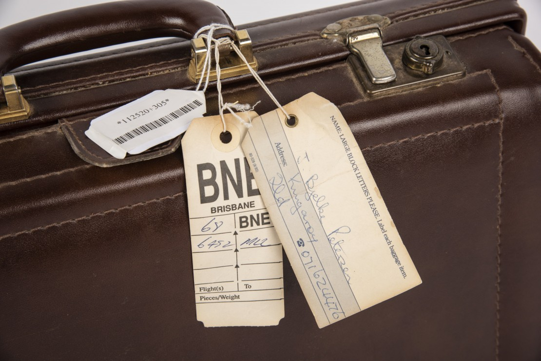 Close up of the original luggage label from Sir Johs leather briefcase