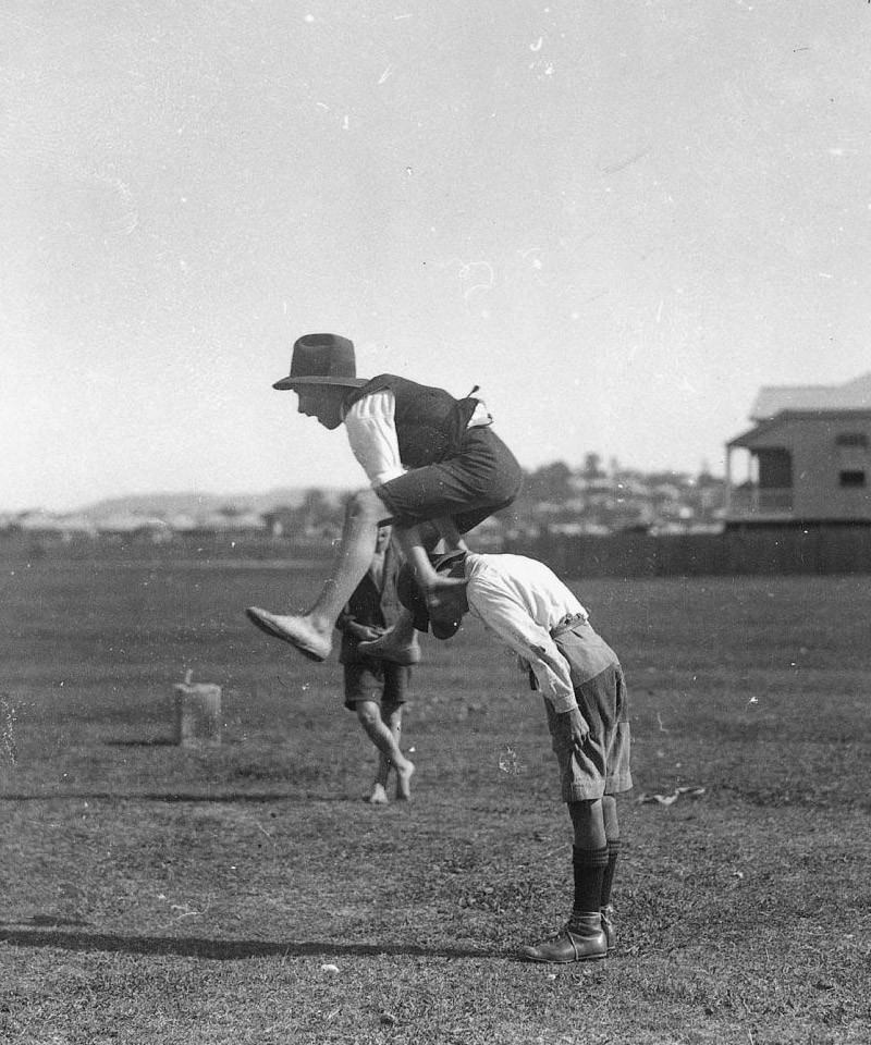 Two boys playing leapfrog 1910-1920