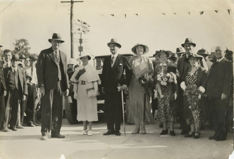 The party of dignitaries includes Manuel Hornibrook on the left and his wife Daphne next to him dressed in all white They are standing next to the Governor Sir Leslie Orme Wilson and his wife Lady Wilson