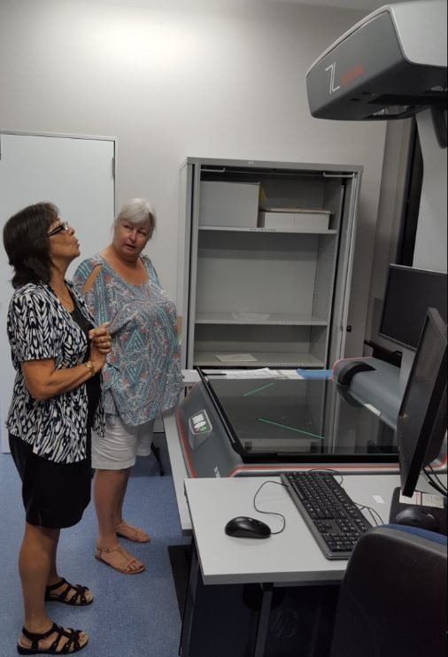 Helen from the Reformatting Unit explaining the Zeutschel scanner to Jeanette from Brisbane Bushwalkers Club