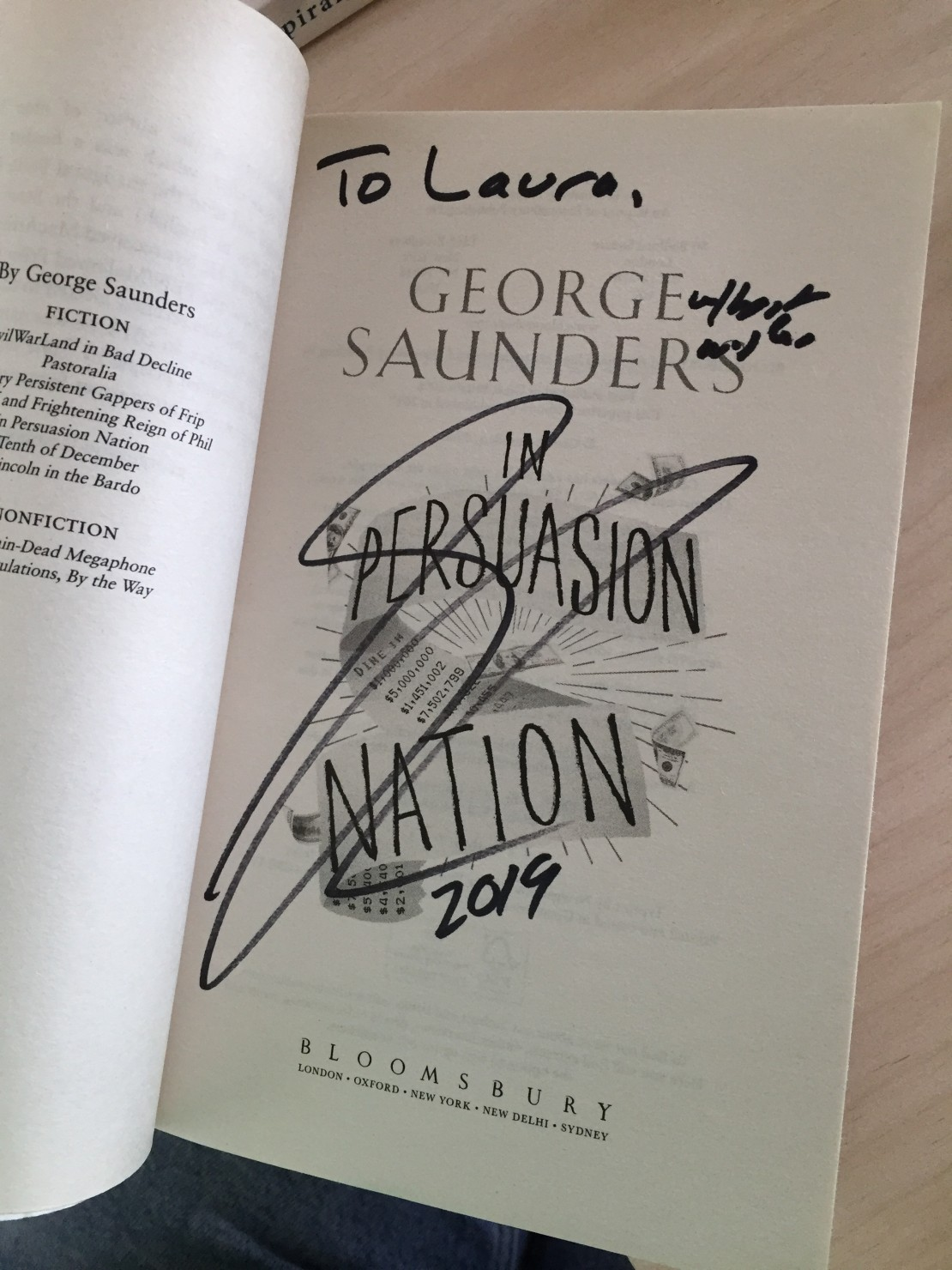 The title page of George Saunderss book In Persuasion Nation It is signed to Laura