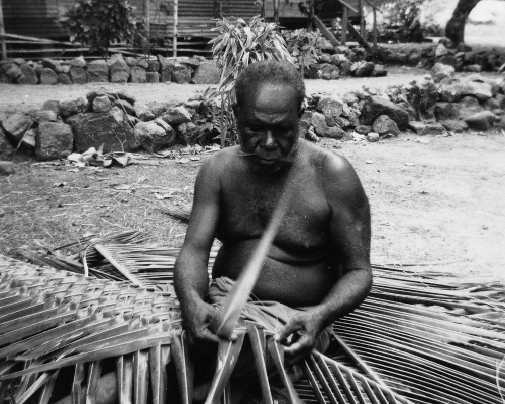 Murray Island man plaiting coconut leaves 1958