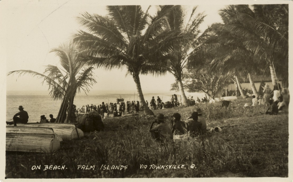 Crowds gathered on the beach at Palm Island Queensland