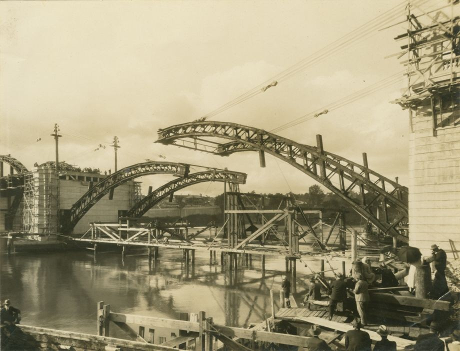 One of a series of photographs taken during the lifting of the third steel spans of the Bridge showing the process until the spans were locked together