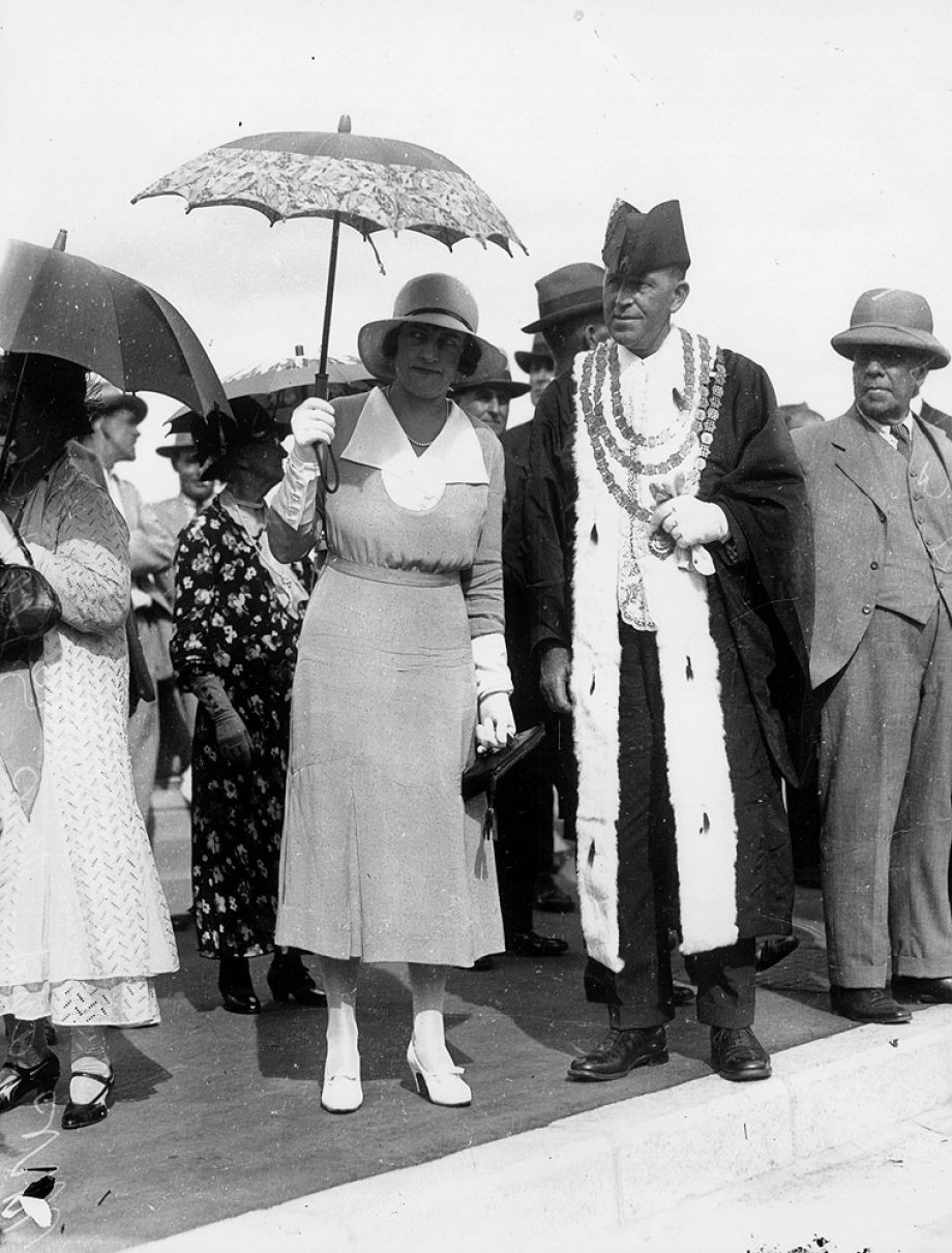 The Lord Mayor and Lady Mayoress photographed at the opening of the Bridge They have an air of anticipation - perhaps to be collected for the car procession over the Bridge The Brisbane Courier wrote that the Lady Mayoress wore Gothic patterned silk in two tones of delphinium blue with a deep white satin rever collar and a white fancy panama hat 31 March 1932