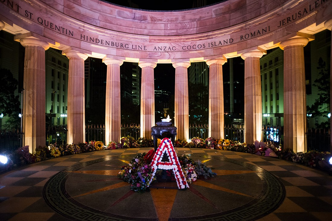 Wreaths surround the Eternal Flame at the Shrine of Remembrance on Anzac Day in Brisbane Queensland 2014